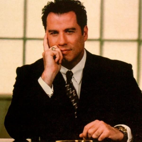 John Travolta - americký herec který se hlásí k scientologii